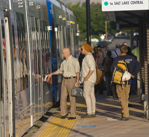 Al Hartmann     Tribune file photo Passengers board an early morning TRAX train at West Valley Central Station for the first workday operation of the new Green Line in August 2011. Ridership numbers have thus far risen to only 80 percent of UTA's projections