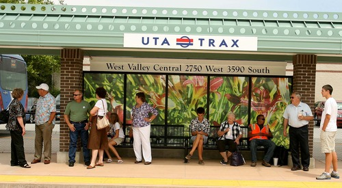 Leah Hogsten   Tribune file photo TRAX riders wait for a train on the new green line in August 2011. Ridership numbers on that line have thus far risen to only 80 percent of UTA's projections.