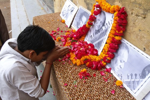 A student pays tribute to legendary Indian sitar player Ravi Shankar at the Bengali Tola Inter College where Shankar had studied in Varanasi, India, Wednesday, Dec. 12, 2012. Shankar, who is credited with connecting the world to Indian music, died Tuesday in San Diego at the age of 92. (AP Photo/Rajesh Kumar Singh)