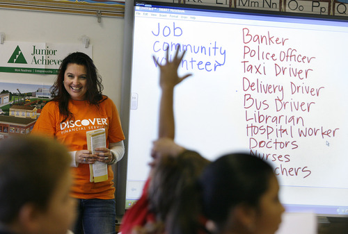 Scott Sommerdorf  |  The Salt Lake Tribune Michelle Sanders, as part of The United Way and Discover Card effort, teach Oquirrh Hills Elementary kids in Teresa Beardall's class about financial literacy as part of a schoolwide teaching experience.