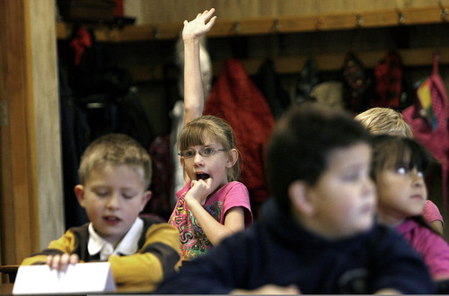 Scott Sommerdorf  |  The Salt Lake Tribune               Second-grader Ruby Schull anxiously raises her hand to answer a question during Ellen Stephenson's and Michelle Sanders' presentaion as part of The United Way and Discover Card effort to teach Oquirrh Hills Elementary kids about financial literacy through a schoolwide teaching experience, Monday, November 19, 2012.