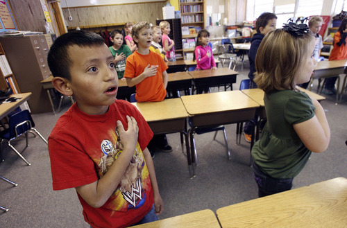 Scott Sommerdorf  |  The Salt Lake Tribune               Second-graders in Teresa Beardall's class at Oquirrh Hills Elementary - including Michael Sepulveda, left - recite the Pledge of Allegiance prior to class, Monday, November 19, 2012. Later, Ellen Stephenson and Michelle Sanders, as part of The United Way and Discover Card effort, taught them about financial literacy through a schoolwide teaching experience.