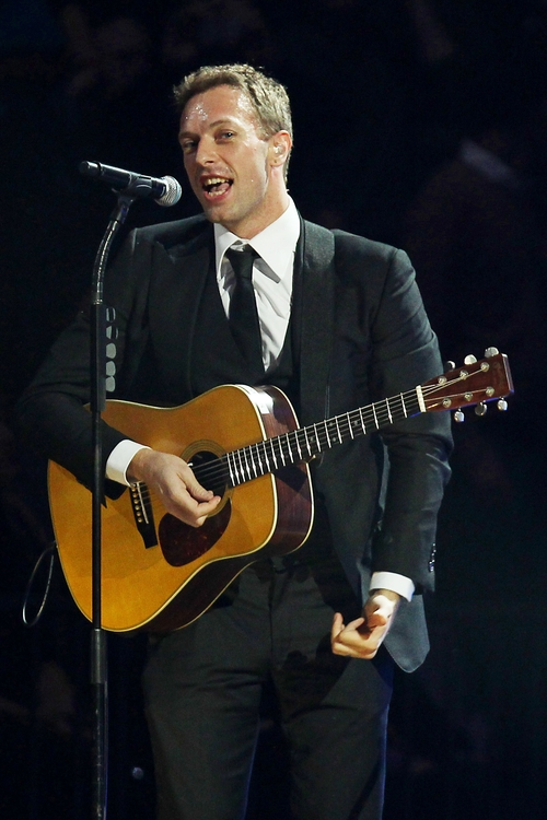This image released by Starpix shows Chris Martin at the 12-12-12 The Concert for Sandy Relief at Madison Square Garden in New York on Wednesday, Dec. 12, 2012. Proceeds from the show will be distributed through the Robin Hood Foundation. (AP Photo/Starpix, Dave Allocca)