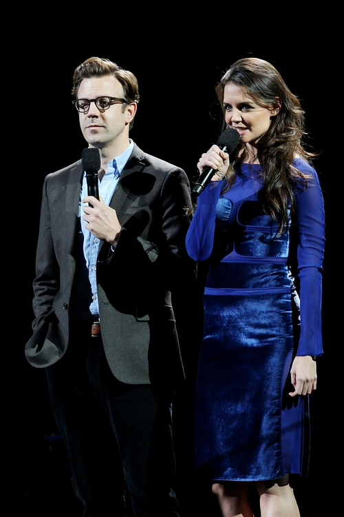 This image released by Starpix shows Jason Sudeikis, left, and Katie Holmes at the 12-12-12 The Concert for Sandy Relief at Madison Square Garden in New York on Wednesday, Dec. 12, 2012. Proceeds from the show will be distributed through the Robin Hood Foundation. (AP Photo/Starpix, Dave Allocca)