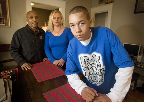 Paul Fraughton  |  Tribune file photo Kaleb Winston stands in his living room with his parents, Kevin and Lisa Winston, on Dec. 28, 2010. They say Kaleb, who is a good student, was wrongly targeted by police as having gang affiliations.