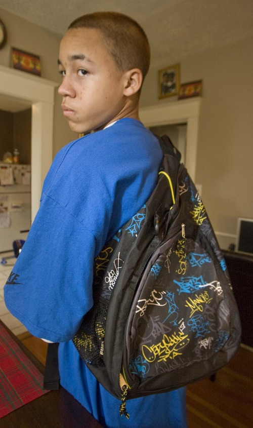 Paul Fraughton  |  Tribune file photo Kaleb Winston shows off his backpack, which was an early Christmas gift from his parents, in 2010. Police claimed the artwork on the bag had gang significance.