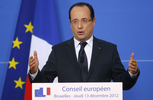 French President Francois Hollande speaks during a media conference at an EU summit in Brussels on Friday, Dec. 14, 2012. After months of bitter debate, European Union countries finally reached two crucial agreements Thursday: They decided to give Greece desperately needed bailout funds and found a compromise to create a single supervisor for their banks, a significant step toward curbing the lenders' power to ruin the finances of governments. (AP Photo/Michel Euler)