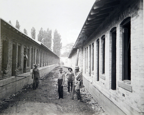 Courtesy Utah Hisorical Society In 1908, workers build a stockade on 200 South between 500 and 600 West to replace posh brothels in downtown Salt Lake City.