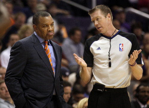 Phoenix Suns head coach Alvin Gentry, left, reacts to NBA official Ed Malloy in the first quarter during an NBA basketball game against the Utah Jazz on Friday, Dec. 14, 2012, in Phoenix. (Rick Scuteri/AP Photos)