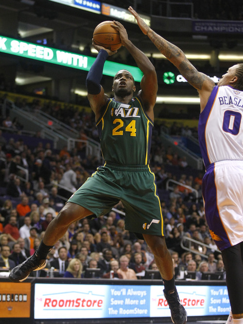 Utah Jazz forward Paul Millsap (24) shoots against Phoenix Suns forward Michael Beasley (0) in the first quarter during an NBA basketball game on Friday, Dec. 14, 2012, in Phoenix. (Rick Scuteri/AP Photos)