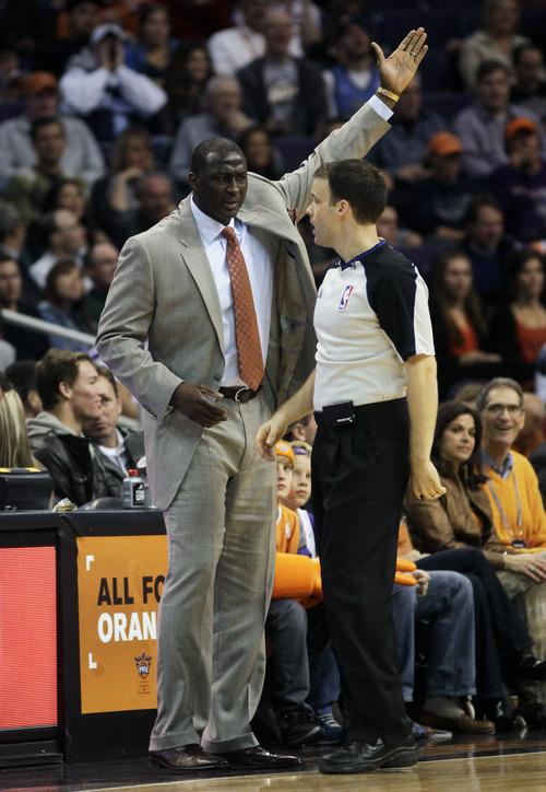 Utah Jazz head coach Tyrone Corbin reacts after call from NBA official Mark Lindsay in the first quarter during an NBA basketball game against the Phoenix Suns on Friday, Dec. 14, 2012, in Phoenix. (Rick Scuteri/AP Photos)