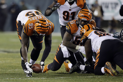 Cincinnati Bengals' Wallace Gilberry recovers a fumble by the Philadelphia Eagles in the second half of an NFL football game, Thursday, Dec. 13, 2012, in Philadelphia. (AP Photo/Mel Evans)