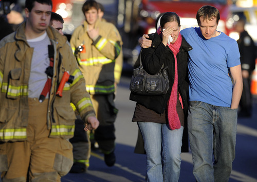 Victims family leave a firehouse staging area following a shooting at the Sandy Hook Elementary School in Newtown, Conn., about 60 miles (96 kilometers) northeast of New York City, Friday, Dec. 14, 2012. An official with knowledge of Friday's shooting said a gunman killed 26 people including 20 children, plus himself.  (AP Photo/Jessica Hill)