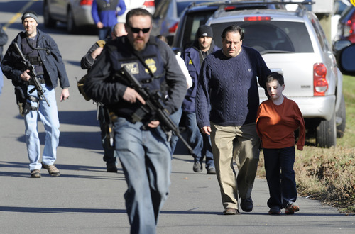 Parents leave a staging area after being reunited with their children following a shooting at the Sandy Hook Elementary School in Newtown, Conn., about 60 miles (96 kilometers) northeast of New York City, Friday, Dec. 14, 2012. An official with knowledge of Friday's shooting said 27 people were dead, including 20 children.  (AP Photo/Jessica Hill)
