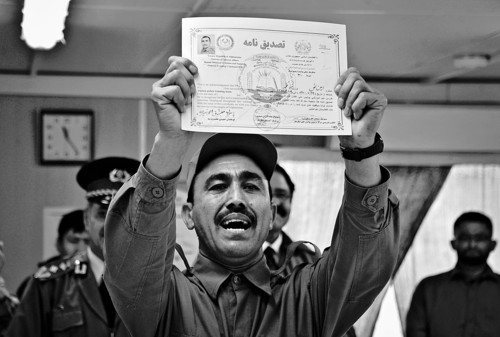 An Afghan national police officer displays his certificate during his graduation ceremony ceremony at a National Police training center in Jalalabad, east of Kabul, Afghanistan, Thursday, Dec. 13, 2012. Over 123 National police officers graduated after receiving 2 months of training in Jalalabad. (AP Photo/Rahmat Gul)