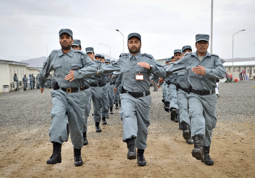 Afghan newly graduated police officers march during their graduation ceremony at a National Police training center in Jalalabad, east of Kabul, Afghanistan, Thursday, Dec. 13, 2012. Over 123 National police officers graduated after receiving 2 months of training in Jalalabad. (AP Photo/Rahmat Gul)