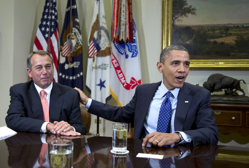 """ADVANCE FOR SUNDAY, DEC. 16, 2012, AND THEREAFTER WITH STORY SLUGGED SPEAKER BOEHNER - FILE - In this Nov. 16, 2012, file photo, President Barack Obama acknowledges House Speaker John Boehner of Ohio while speaking to reporters in the Roosevelt Room of the White House in Washington, as he hosted a meeting of the bipartisan, bicameral leadership of Congress to discuss the deficit and economy. The 63-year-old speaker has been caught up ever since in a monumental struggle over taxes and spending aimed at keeping the country from taking a yearend dive over the """"fiscal cliff."""" Obama is tugging Boehner one way in pursuit of a budget deal, while conservatives yank the other way, some howling that the speaker already is going wobbly on them and turning vindictive against those in his party who dare disagree. (AP Photo/Carolyn Kaster, File)"""