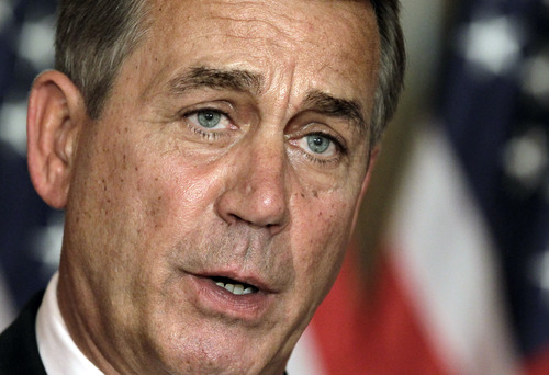 """ADVANCE FOR SUNDAY, DEC. 16, 2012, AND THEREAFTER WITH STORY SLUGGED SPEAKER BOEHNER - FILE - In this July 30, 2011, file photo, House Speaker John Boehner, R-Ohio, speaks at a news conference as the debt crisis goes unresolved on Capitol Hill in Washington. Boehner has been caught up in a monumental struggle over taxes and spending aimed at keeping the country from taking a yearend dive over the """"fiscal cliff."""" President Barack Obama is tugging Boehner one way in pursuit of a budget deal, while conservatives yank the other way, some howling that the speaker already is going wobbly on them and turning vindictive against those in his party who dare disagree. (AP Photo/J. Scott Applewhite, File)"""