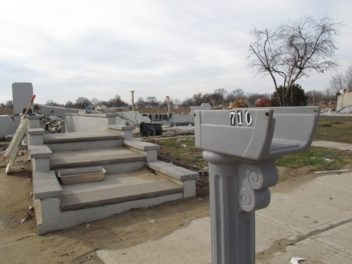 Half a mailbox and stairs leading to nowhere are all that are left of this house in Union Beach N.J., shown here on Dec., 12, 2012. New Jersey's main environmental groups are calling on state and local governments to use the painful lessons learned from Superstorm Sandy when making decisions on where and how to rebuild. (AP Photo/Wayne Parry)