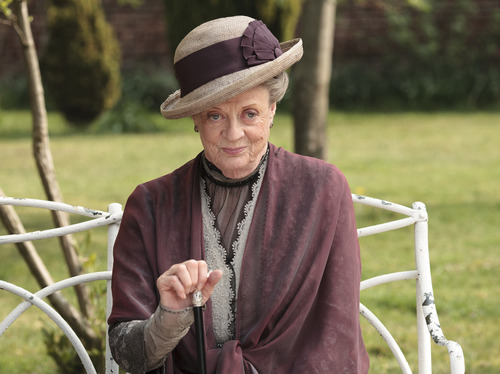 "In this image released by PBS,  Maggie Smith as the Dowager Countess Grantham, is shown in a scene from the second season on ""Downton Abbey.""  Smith was nominated for a Golden Globe award for best supporting actress in mini-series or TV movie for her role in the series, Thursday, Dec. 13, 2012. The 70th annual Golden Globe Awards will be held on Jan. 13.  (AP Photo/PBS, Carnival Film & Television Limited 2011 for MASTERPIECE, Nick Briggs)"