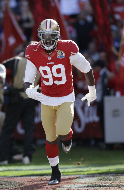 San Francisco 49ers outside linebacker Aldon Smith during introductions before an NFL football game against the Miami Dolphins in San Francisco, Sunday, Dec. 9, 2012. (AP Photo/Marcio Jose Sanchez)