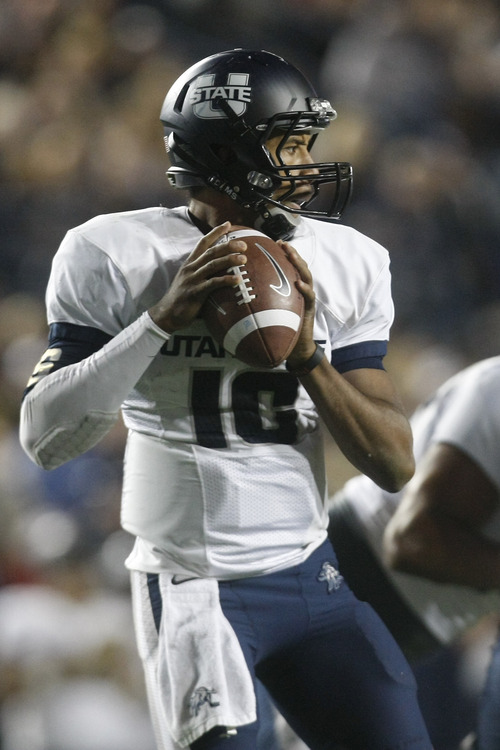 Chris Detrick  |  The Salt Lake Tribune USU quarterback Chuckie Keeton  looks to throw the ball against BYU at LaVell Edwards Stadium on Oct. 5, 2012.