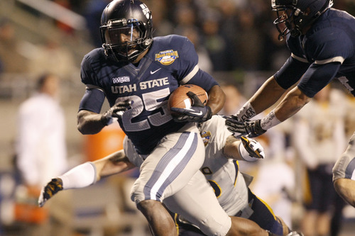 Chris Detrick  |  The Salt Lake Tribune Utah State Aggies running back Kerwynn Williams (25) runs the ball during the fourth quarter of the Famous Idaho Potato Bowl at Bronco Stadium Saturday December 15, 2012.  The Aggies beat the Rockets, 41-15.