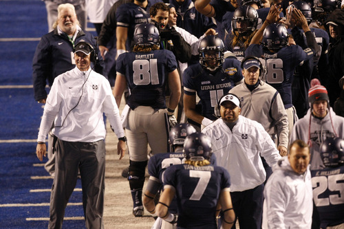 Chris Detrick  |  The Salt Lake Tribune Utah State Aggies head coach Gary Andersen reacts after running back Kerwynn Williams (25) scores a touchdown during the Famous Idaho Potato Bowl at Bronco Stadium Saturday December 15, 2012.  The Aggies beat the Rockets, 41-15.