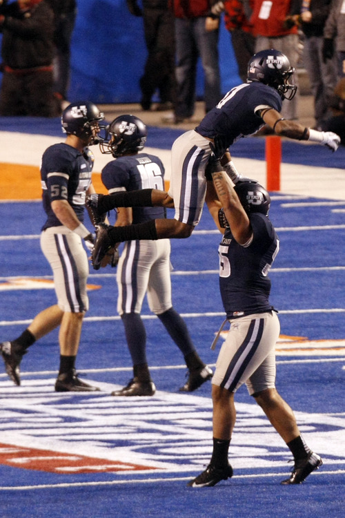 Chris Detrick  |  The Salt Lake Tribune Utah State Aggies cornerback Will Davis (17) and Utah State Aggies linebacker Bojay Filimoeatu (55) celebrate during the Famous Idaho Potato Bowl at Bronco Stadium Saturday December 15, 2012.  The Aggies beat the Rockets, 41-15.