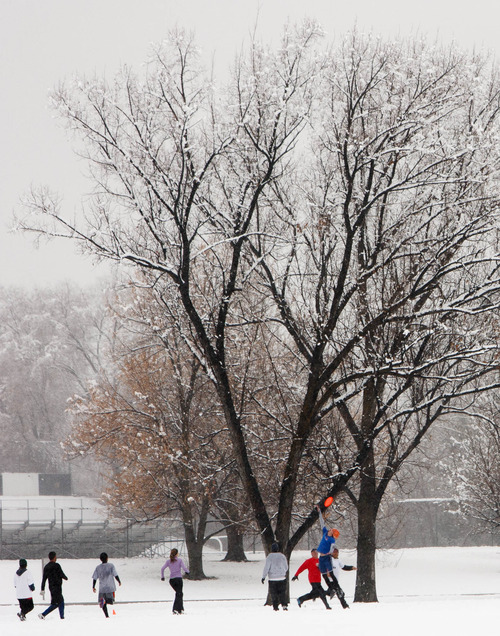 Trent Nelson  |  The Salt Lake Tribune An ultimate frisbee match on a snowy afternoon in Sugar House Park in Salt Lake City, Saturday December 15, 2012.
