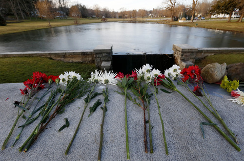 Flowers honoring the victims that died a day earlier when a gunman opened fire at an elementary school lay on a bridge near Hawley Pond, Saturday, Dec. 15, 2012, in Newtown, Conn. The massacre of 26 children and adults at Sandy Hook Elementary school elicited horror and soul-searching around the world even as it raised more basic questions about why the gunman, 20-year-old Adam Lanza, would have been driven to such a crime and how he chose his victims.  (AP Photo/Julio Cortez)