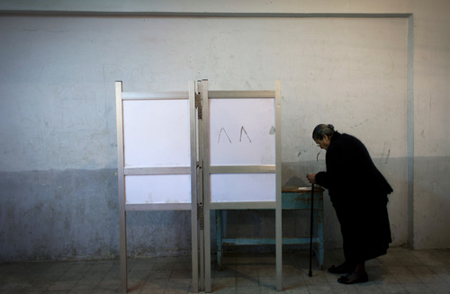 An Egyptian woman votes at polling center during a referendum on a disputed constitution drafted by Islamist supporters of President Mohammed Morsi in Cairo, Egypt, Saturday, Dec. 15, 2012. Egyptians were voting on Saturday on a proposed constitution that has polarized their nation, with Morsi and his Islamist supporters backing the charter, while liberals, moderate Muslims and Christians oppose it. (AP Photo/Nasser Nasser)