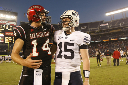 Photo by Chris Detrick  |  The Salt Lake Tribune  San Diego State's Ryan Lindley #14 and Brigham Young's Max Hall #15 talk after the game at Qualcomm Stadium Saturday October 17, 2009. BYU won the game 38-28.