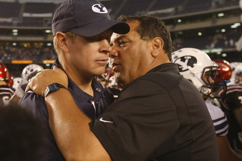 Photo by Chris Detrick  |  The Salt Lake Tribune  BYU coach Bronco Mendenhall talks with SDSU coach Brady Hoke after the game at Qualcomm Stadium Saturday October 17, 2009. BYU won the game 38-28.