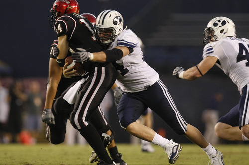 Photo by Chris Detrick  |  The Salt Lake Tribune  Brigham Young's Jan Jorgensen #84 sacks San Diego State's Ryan Lindley #14 during the second half of the game at Qualcomm Stadium Saturday October 17, 2009. BYU won the game 38-28.