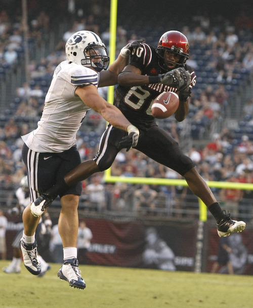 Photo by Chris Detrick  |  The Salt Lake Tribune  Brigham Young's Jordan Pendleton #1 breaks up a pass intended for San Diego State's Vincent Brown #80 during the second half of the game at Qualcomm Stadium Saturday October 17, 2009. BYU won the game 38-28.