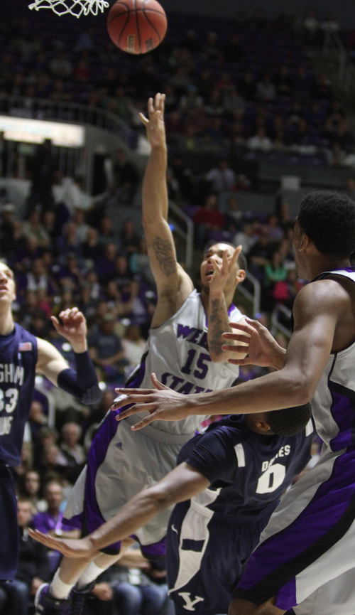 Rick Egan    The Salt Lake Tribune   Weber State Wildcats guard/forward Davion Berry (15) is called for charging as he collides with Brigham Young Cougars forward Brandon Davies (0) in basketball action, BYU vs. Weber State, in Ogden, Saturday, December 15, 2012.