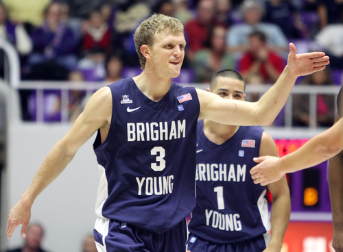 Rick Egan    The Salt Lake Tribune   Brigham Young Cougars guard Tyler Haws (3) celebrates after BYU goes up by 15 late in the game, in basketball action, BYU vs. Weber State, in Ogden, Saturday, December 15, 2012.