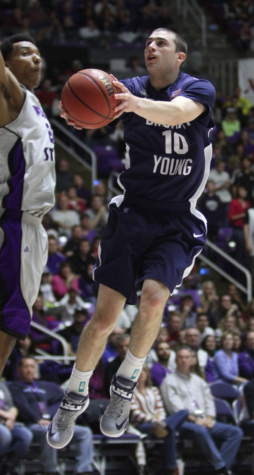 Rick Egan    The Salt Lake Tribune   Brigham Young Cougars guard Matt Carlino (10) soars in the air for a shot, in basketball action, BYU vs. Weber State, in Ogden, Saturday, December 15, 2012.