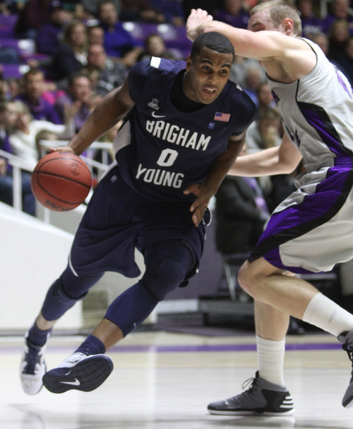 Rick Egan    The Salt Lake Tribune   Brigham Young Cougars forward Brandon Davies (0) takes the ball to the hoop,  pastWeber State Wildcats center Kyle Tresnak (44) in basketball action, BYU vs. Weber State, in Ogden, Saturday, December 15, 2012.