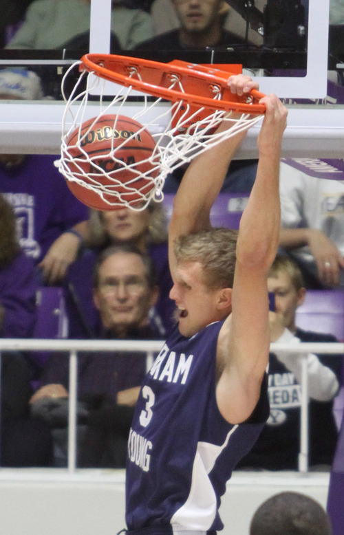 Rick Egan    The Salt Lake Tribune   Brigham Young Cougars guard Tyler Haws (3) dunks the ball, in basketball action, BYU vs. Weber State, in Ogden, Saturday, December 15, 2012.