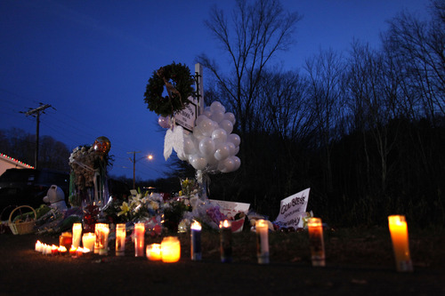 A memorial for shooting victims is seen near Sandy Hook Elementary School, Saturday, Dec. 15, 2012 in Newtown, Conn.  A gunman walked into Sandy Hook Elementary School in Newtown Friday and opened fire, killing 26 people, including 20 children. (AP Photo/Jason DeCrow)