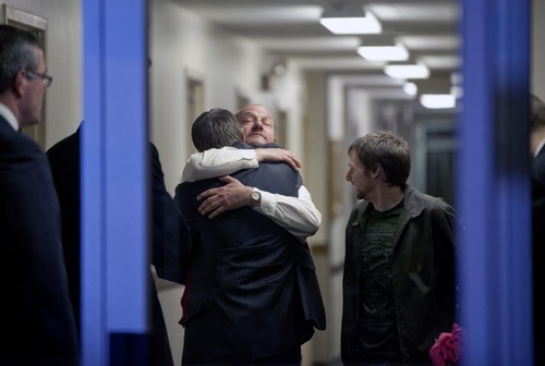 Randy Parker, facing camera, embraces his son Robbie Parker, the father of six-year-old Emilie who was killed in the Sandy Hook Elementary School shooting, before he addresses the media on the death of his daughter at a news conference, Saturday, Dec. 15, 2012, in Newtown, Conn. (AP Photo/David Goldman)