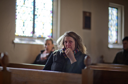 Mary Fellows, of Newtown, Conn., weeps while waiting for a prayer service to begin at St John's Episcopal Church, Saturday, Dec. 15, 2012, in Newtown. The massacre of 26 children and adults at Sandy Hook Elementary school elicited horror and soul-searching around the world even as it raised more basic questions about why the gunman, 20-year-old Adam Lanza, would have been driven to such a crime and how he chose his victims. (AP Photo/David Goldman)