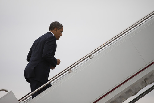 President Barack Obama boards Air Force One, Sunday, Dec. 16, 2012, at Andrews Air Force Base, Md., en route to Newtown, Conn., for an interfaith vigil for the victims of the Sandy Hook Elementary School shooting. A gunman walked into the school on Friday and opened fire, killing 26 people, including 20 children, before killing himself. (AP Photo/ Evan Vucci)