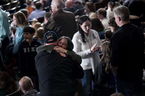 Residents greet each other before the start of an interfaith vigil for the victims of the Sandy Hook Elementary School shooting on Sunday, Dec. 16, 2012 at Newtown High School in Newtown, Conn. A gunman walked into Sandy Hook Elementary School Friday and opened fire, killing 26 people, including 20 children.  (AP Photo/Evan Vucci)