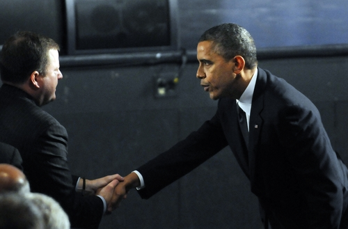 President Barack Obama greets State Senate Minority Leader John McKinney, R-Fairfield, on his arrival, before the start of an interfaith vigil for the victims of the Sandy Hook Elementary School shooting inside the Newtown High School auditorium in Newtown, Conn., Sunday night, Dec. 16, 2012. A gunman walked into the elementary school Friday and opened fire, killing 26 people, including 20 children. (AP Photo/The Hartford Courant, Stephen Dunn, Pool)