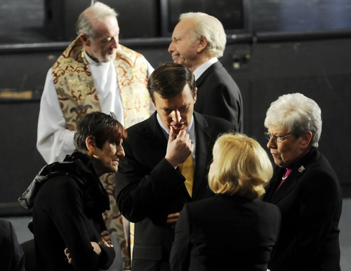 U.S. Sen. Joseph Lieberman, I-Conn., top right, Rep. Rosa DeLauro, D-Conn., left, Sen-elect Chris Murphy, center, and Lt. Gov. Nancy Wyman, right, wait for the arrival of President Barack Obama before the start of an interfaith vigil for the victims of the Sandy Hook Elementary School shooting inside the Newtown High School auditorium in Newtown, Conn., Sunday night, Dec. 16, 2012. A gunman walked into the elementary school Friday and opened fire, killing 26 people, including 20 children. (AP Photo/The Hartford Courant, Stephen Dunn, Pool)