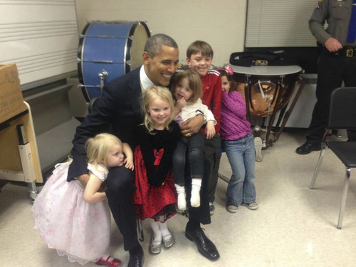 President Barack Obama poses with surviving children of the Parker family in Newtown, Conn., Dec. 16, 2012. The Parker children from left, Samantha Parker, 3, Madeline Parker, 4, with three other unidentified children from the families of the victims. Courtesy Parker Family