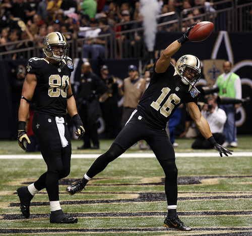 New Orleans Saints wide receiver Lance Moore (16) celebrates his touchdown reception with tight end Jimmy Graham (80) in the first half of an NFL football game at the Mercedes-Benz Superdome in New Orleans, Sunday, Dec. 16, 2012. (AP Photo/Bill Haber)